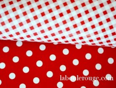 White polka dots on red coated gift wrapping paper Red white gingham Europe